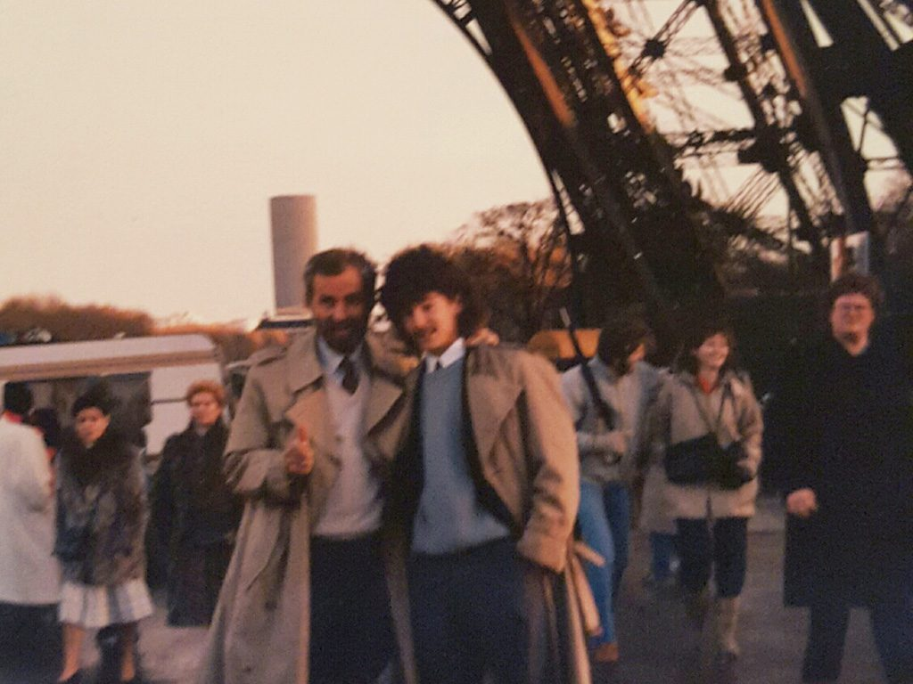 With me, standing under the Eiffel Tower in Paris, 1985.